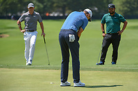 Ross Fisher (ENG) sinks his putt at Rory McIlroy (NIR) and J.J. Spaun (USA) watch from just off the green on 8 during 3rd round of the 100th PGA Championship at Bellerive Country Club, St. Louis, Missouri. 8/11/2018.<br /> Picture: Golffile | Ken Murray<br /> <br /> All photo usage must carry mandatory copyright credit (&copy; Golffile | Ken Murray)