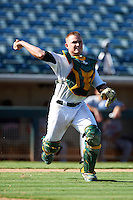 Phoenix Desert Dogs catcher Max Stassi #16, of the Oakland Athletics organization, during an Arizona Fall League game against the Surprise Saguaros at Phoenix Municipal Stadium on October 18, 2012 in Phoenix, Arizona.  The game was called after eleven innings with a 2-2 tie.  (Mike Janes/Four Seam Images)