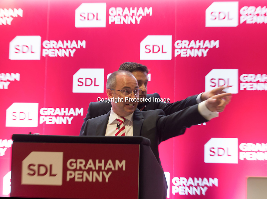 09/06/16<br /> <br /> ***FAO WENDY***<br /> <br /> Graham Penny, unveils new branding at today's auction at ipro Stadium, Derby