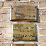 Brass name plate outside dental surgery, Ipswich, Suffolk, England