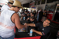 Jul. 27, 2013; Sonoma, CA, USA: NHRA a young fan shaking the hand of funny car driver Tony Pedregon during qualifying for the Sonoma Nationals at Sonoma Raceway. Mandatory Credit: Mark J. Rebilas-