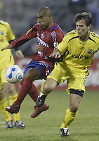 08 November 2006: CSD Municipal's Juan Carlos Plata, left, kicks the ball past Columbus Crew's Stefani Miglioranzi during the second half in Columbus, Ohio.<br />