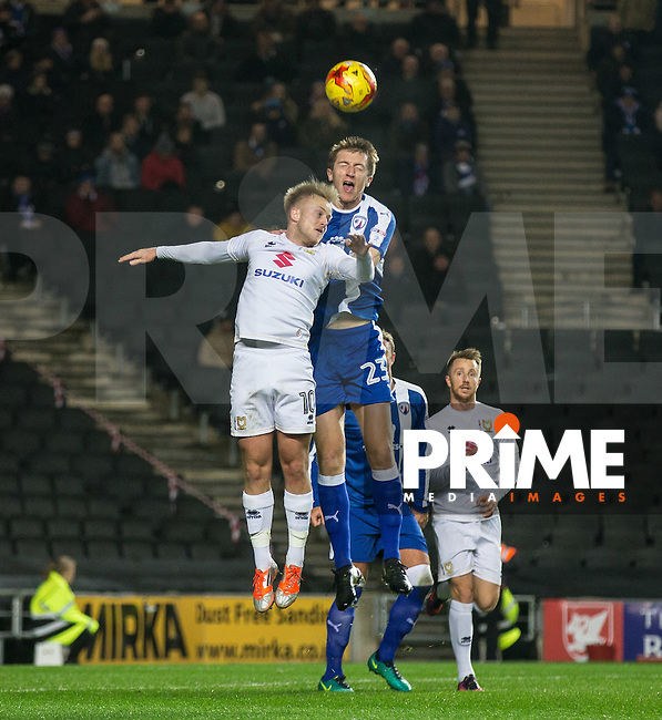 Ben Reeves of Milton Keynes Dons & Tom Anderson of Chesterfield in the air during the Sky Bet League 1 match between MK Dons and Chesterfield at stadium:mk, Milton Keynes, England on 22 November 2016. Photo by Andy Rowland.