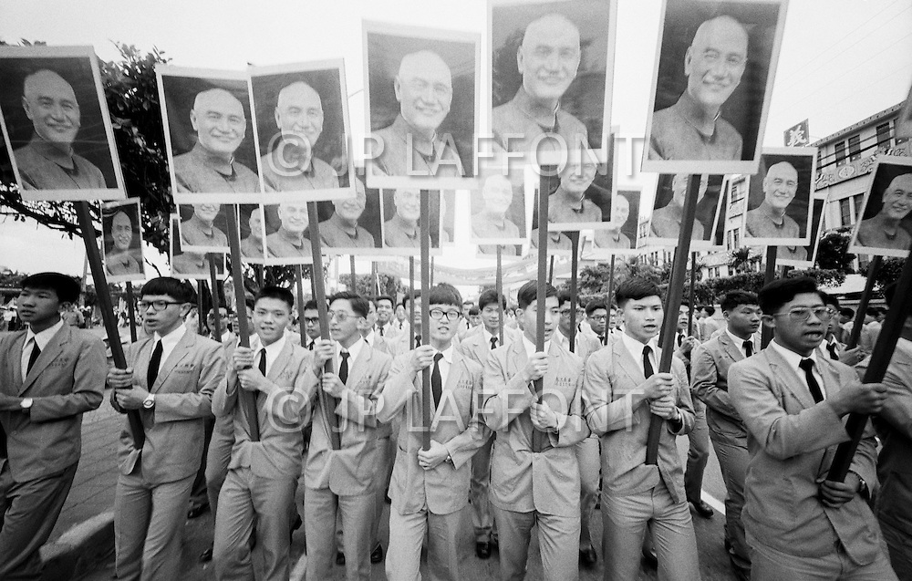10 Oct 1977, Taipei, Taiwan --- Young Taiwanese display portraits of former President Chiang Kai-shek during a national holiday in Taiwan. --- Image by © JP Laffont