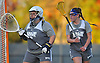 Lauren Young #28, New York Institute of Technology goalie, left, and teammate #21 Erin Smith defend the net during women's lacrosse team practice on NYIT's campus in Old Westbury on Wednesday, Oct. 19, 2016.
