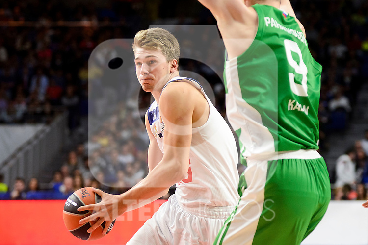 Real Madrid's player Luka Doncic and Unics Kazan's player Artsiom Parakhouski during match of Turkish Airlines Euroleague at Barclaycard Center in Madrid. November 24, Spain. 2016. (ALTERPHOTOS/BorjaB.Hojas)