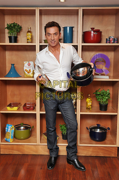 Bruno Tonioli.Strictly Come Dancing judge hosts cookery class to launch his new QVC cookware range, L'Atelier des Chefs, 19 Wigmore Street, London, England..September 7th, 2012.full length white shirt pan pot jeans denim colander .CAP/BF.©Bob Fidgeon/Capital Pictures.