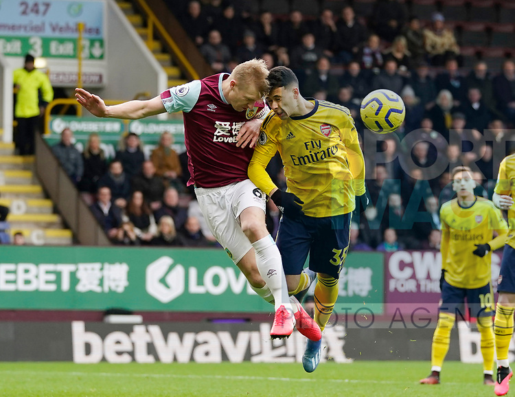 Ben Mee of Burnley and Gabriel Martinelli of Arsenal in an aerial dual during the Premier League match at Turf Moor, Burnley. Picture date: 2nd February 2020. Picture credit should read: Andrew Yates/Sportimage