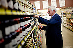 Darrell Corti straightens some shelves at Corti Bros. in Sacramento, Calif., March 3, 2012.