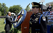 United States President Barack Obama places a flower & ribbon on the memorial wreath at the National Peace Officers Memorial Service, an annual ceremony honoring law enforcement who were killed in the line of duty in the previous year, at the US Capitol in Washington, DC, May 15, 2015. <br /> Credit: Olivier Douliery / Pool via CNP