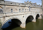 Pulteney Bridge spanning the River Avon in Bath, England completed by 1774 designed Robert Adam in a Palladian style.