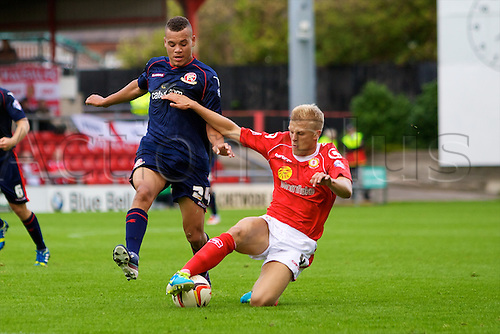 14.09.2013 Crewe, England. Crewe Alexandra defender Harry Davis and Walsall FC forward Troy Hewitt in action during the League One game between Crewe Alexandra and Walsall FC from the Alexandra Stadium