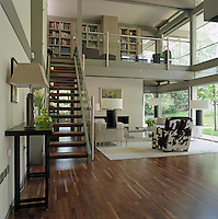 The library is located on the mezzanine level above the open-plan living area