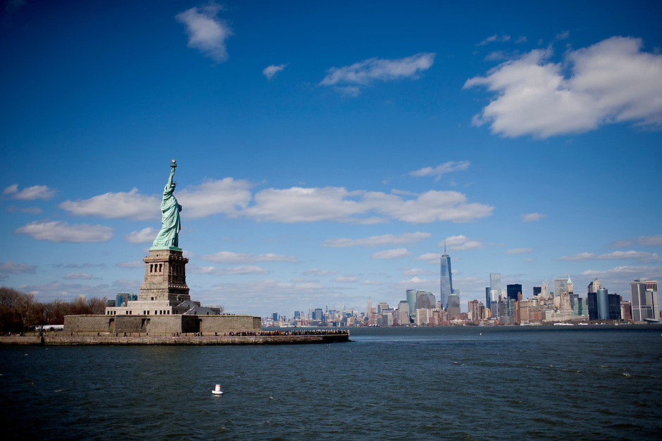The Statue of Liberty is seen on Saturday, April 5, 2014, in New York. In the distance to the right is Lower Manhattan. (Photo by James Brosher)