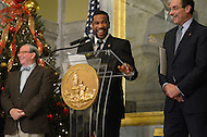 December 22, 2011  (Washington, DC)  IBF/WBA Junior Welterweight Champion Lamont Peterson (center) speaks to a crowd as he was given the key to the city by District of Columbia Mayor Vincent Gray (right). Peterson won the Title with his win over Amir Khan at the DC Convention Center.  (Photo by Don Baxter/Media Images International)
