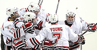 Nebraska-Omaha's Ryan Walters (right) and his linemates celebrate the freshman's goal which stood to be the game-winner. UNO rallied to beat St. Cloud State 4-3 Saturday night at Qwest Center Omaha. (Photo by Michelle Bishop).