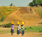 In northern Uganda, community labor is an important component of U.S. AID and Winrock International's $30 million NUDEIL construction project  to build new roads, water wells, and schools.  Most of the farmer workers lived isolated in government camps for up to fifteen years, during the brutal insurgency by the Lords Resistance Army(LRA).  The construction program not only seeks to help boost the local economy, but also provide hard to obtain daily wages to local residents who are mainly subsistence farmers.  ..