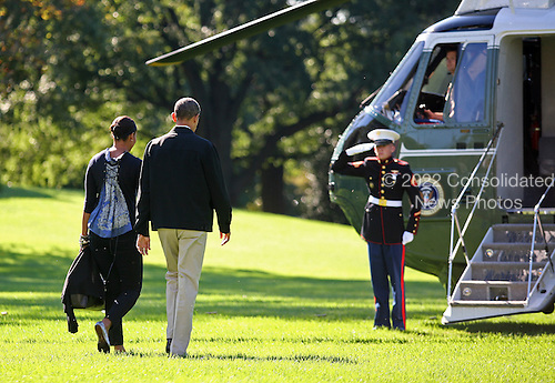 United States President Barack Obama and first lady Michelle Obama depart the South Lawn of the White House en route Camp David where they are to spend the weekend, Saturday, October 2, 2010..Credit: Martin H. Simon - Pool via CNP