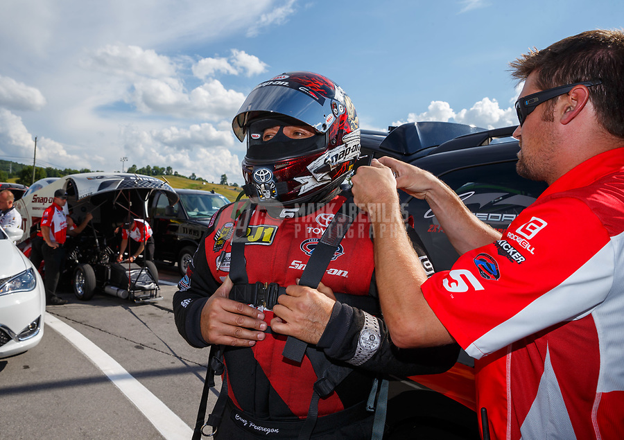 Jun 16, 2017; Bristol, TN, USA; Crew member for NHRA funny car driver Cruz Pedregon during qualifying for the Thunder Valley Nationals at Bristol Dragway. Mandatory Credit: Mark J. Rebilas-USA TODAY Sports