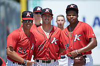 (L-R) Andrew Perez (24), Bennett Sousa (27), and Luis Ledo (39) pose for a photo prior to the game against the Kannapolis Intimidators at Kannapolis Intimidators Stadium on August 5, 2018 in Kannapolis, North Carolina. The Grasshoppers defeated the Intimidators 2-1 in game one of a double-header.  (Brian Westerholt/Four Seam Images)