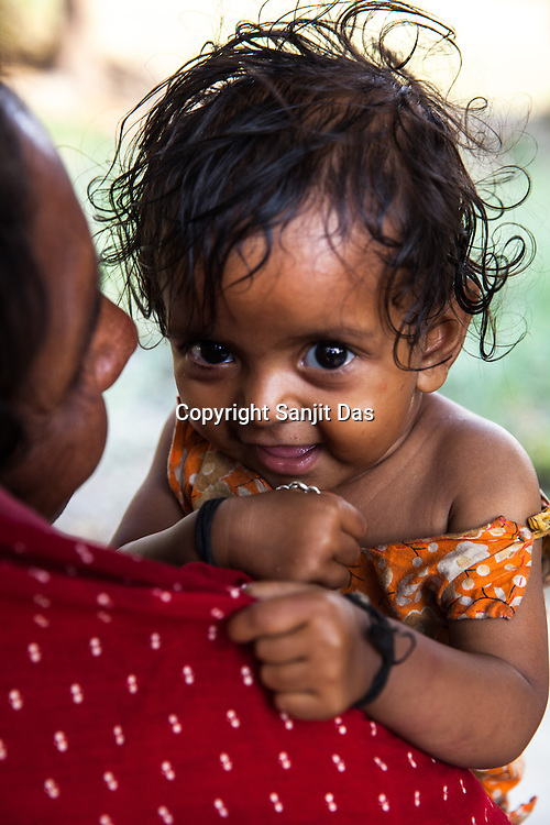 11 month old, Sita Mandal seen with her grand-daughter, Gita Devi (50) in thier house in Bhardaha in Saptari, Nepal.