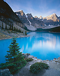 Banff National Park, Alberta, Canada:  Morning sun on Wenkchemna Peaks with reflections on blue waters of Moraine Lake - Valley of Ten Peaks