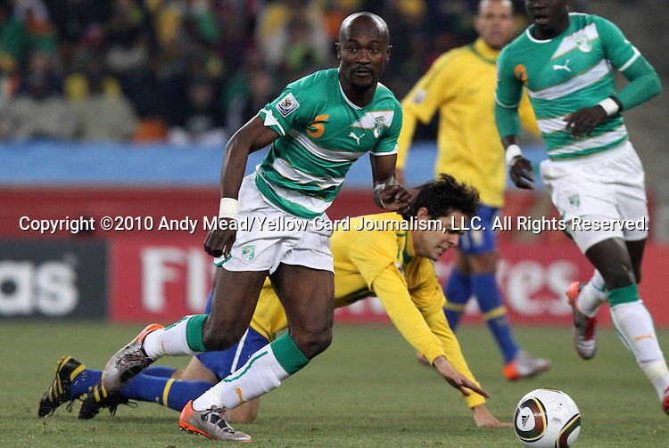20 JUN 2010: Didier Zokora (CIV) (5) pushes past a falling Kaka (BRA) (behind). The Brazil National Team defeated the C'ote d'Ivoire National Team 3-1 at Soccer City Stadium in Johannesburg, South Africa in a 2010 FIFA World Cup Group G match.