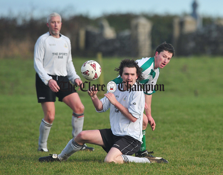 Rineanna's Conor Sweeney battles for posession with Dave Hickey of Bridge Celtic. Photograph by Declan Monaghan