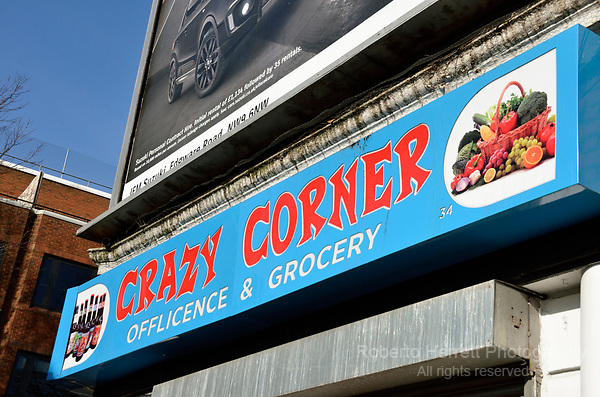 'Crazy Corner' sign outside a small corner shop, London, UK.