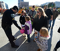 NWA Democrat-Gazette/ANDY SHUPE<br /> Thursday, Oct. 31, 2019, during the 18th Annual Trick-or-Treat on the Square hosted by Experience Fayetteville on the Fayetteville square. Businesses on the square join city departments in handing out candy to trick-or-treaters. Visit nwadg.com/photos to see more photographs from the evening.