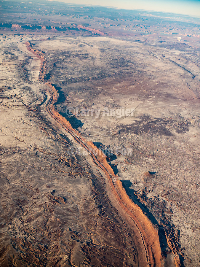 Vermilion Cliffs, Arizona, with snow from window seat on a United Airlines flight from Chicago to Los Angeles over America's Flyover County.