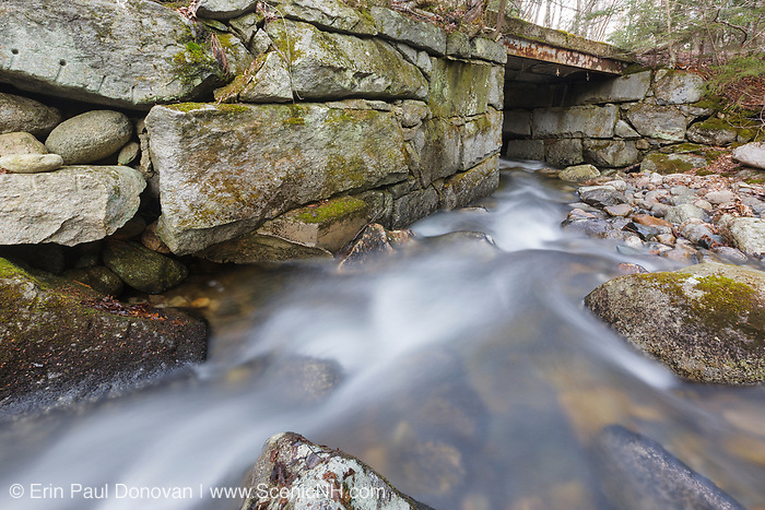 Looking downstream at an old bridge, which crosses Skookumchuck Brook along the Notchway Trail. The Notchway Trail is the main trail of the Lafayette Ski Trails and follows the old Route 3 between Route 141 and Route 18 in the town of Franconia, New Hampshire