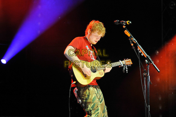 Ed Sheeran .performing at V Festival, Hylands Park, Chelmsford, Essex, England. .18th August 2012.on stage in concert live gig performance music half length red t-shirt tattoo green camouflage side guitar .CAP/MAR.© Martin Harris/Capital Pictures.