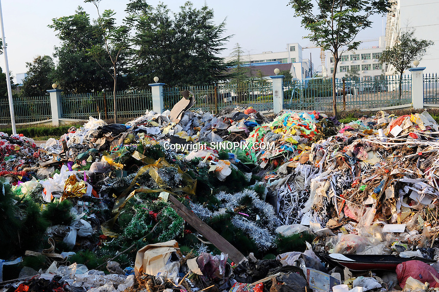 Christmas trees and decorations dumped outside Yiwu Festival Gifts Co Ltd in Yi Wu, China. The factory makes Christmas trees for UK retail giant B & Q. Yi Wu exports 40-50 % of the entire European Christmas decorations and 70 % of US and Mexico's Christmas gifts come from Yi Wu.