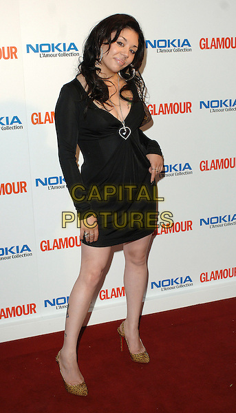 MUTYA BEUNA.attending the Glamour Women Of The Year Awards, Berkeley Square Gardens, London, 5th June 2007..full length black dress piercing tattoo on leg leopard print Christian Louboutin shoes heart necklace tattoos hand on hip.CAP/BEL.©Tom Belcher/Capital Pictures.
