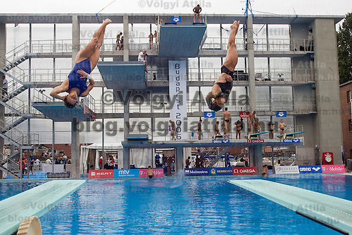 Competitors practice before the diving competition during the Swimming European Championships.