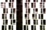 The abstract photograph of a facade with symmetrically arranged windows