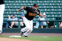 June 21, 2009:  Rochester Red Wings First Baseman Brock Peterson runs in to field a bunt during a game at Frontier Field in Rochester, NY.  The Rochester Red Wings are the International League Triple-A affiliate of the Minnesota Twins.  Photo by:  Mike Janes/Four Seam Images