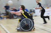 27 MAY 2013 - DONCASTER, GBR - Luke White of Stoke Mandeville Storm reaches to collect a pass during the 2013 Great Britain Wheelchair Rugby Nationals final against Kent Crusaders at The Dome in Doncaster, South Yorkshire .(PHOTO (C) 2013 NIGEL FARROW)