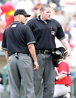Home plate umpire Chris Conroy and Vic Carapazza during a game between the Rochester Red Wings and Norfolk Tides at Frontier Field in Rochester, New York;  May 31, 2010.   Norfolk defeated Rochester by the score of 2-1.  Photo By Mike Janes/Four Seam Images