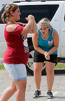 NWA Democrat-Gazette/DAVID GOTTSCHALK  Madison Fontenot (right), a sophomore at Greenland High School, watches the footwork of Hayleigh Anderson, a freshman, during the Greenland High School Band practice Thursday, August 6, 2015 at the school. The 42 member band under the direction of Jeremy Doss is preparing the fall pep rallies, football half time performances and competitions taking place this fall.