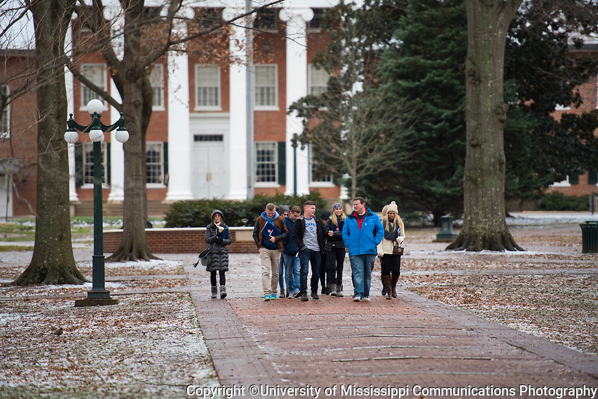 Admissions counselor Mason Tilghman, second from right, gives a tour while the rest of the campus takes a snow day.  Photo by Kevin Bain/University Communications Photography