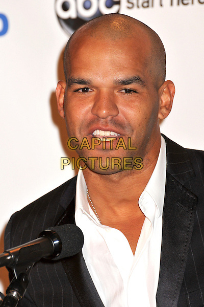 AMAURY NOLASCO .2009 ALMA Awards Press Conference held at Beso, Hollywood, CA, .25th August 2009..portrait headshot stubble white shirt facial hair speaking talking microphone .CAP/ADM/BP.©Byron Purvis/AdMedia/Capital Pictures.