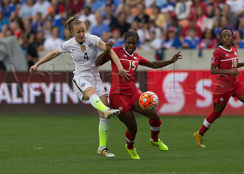 21.02.2016. Houston, TX, USA.  USA Defender Becky Sauerbrunn (4) and Canada Forward Nichelle Prince (15) fight for ball during the Women's Olympic qualifying soccer final match between Canada and USA at BBVA Compass Stadium in Houston, Texas.