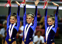 30 SEPTEMBER 1999 - OSAKA, JAPAN: (L-R) ALINA KABAEVA, YULIA BARSOUKOVA, OLGA BELOVA of Russia celebrate team gold at 1999 World Championships in Osaka, Japan. Just out of the frame is Irina Tchachina, 2004 Athens Olympic silver medalist.