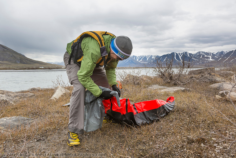 Inflating a packraft.