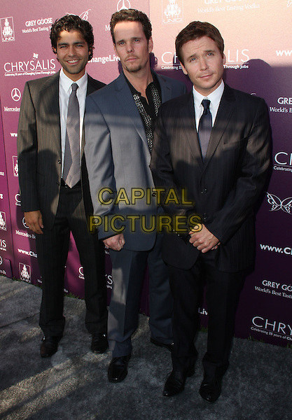 ADRIAN GRENIER, KEVIN DILLON & KEVIN CONNOLLY .8th Annual Chrysalis Butterfly Ball held at A Private Residence, Los Angeles, California, USA..June 6th, 2009.full length black grey gray suit.CAP/ADM/KB.©Kevan Brooks/AdMedia/Capital Pictures.