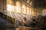 The interior of the Palazzo Reale (Royal Palace) in Naples Italy illuminated by sunrays.