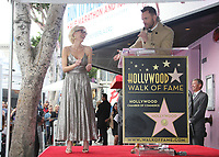 HOLLYWOOD, CA - JANUARY 8: Gillian Anderson, Joel McHale, at Gillian Anderson Honored With Star On The Hollywood Walk Of Fame at On The Hollywood Walk Of Fame in Hollywood, California on January 8, 2018. <br /> CAP/MPI/FS<br /> &copy;FS/MPI/Capital Pictures