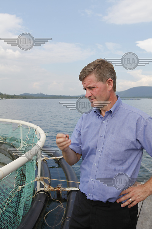 Visiting a fish farming project. Minister of the Environment and International Development, Erik Solheim, during a visit to Khao Lak, north of Phuket. The area was severley hit by the Tsunami that struck Asia 26/12/2004.The area has since been rebuilt, and tourists have returned.  .©Fredrik Naumann/Felix Features.